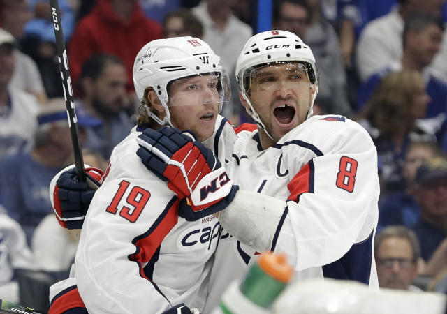 Washington Capitals center Nicklas Backstrom (19) celebrates his goal against the Tampa Bay Lightning with left wing Alex Ovechkin (8) during the first period of an NHL hockey game Saturday, March 30, 2019, in Tampa, Fla. (AP Photo/Chris O'Meara)
