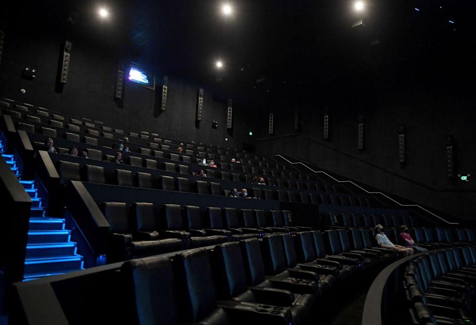 """<p>Socially-distanced guests wait for the movie """"Star Wars: Episode V - The Empire Strikes Back"""" to start at AMC Town Square 18 on August 20 in Las Vegas, Nevada.</p>"""
