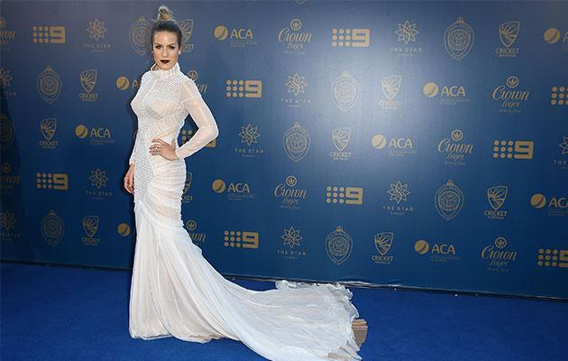 <p>The WAG was a showstopper in the long-sleeved lacy number.</p>