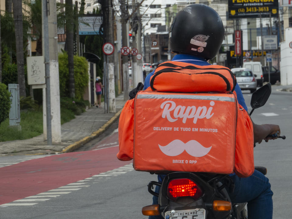 São Paulo, Brazil - February 22, 2021: motorcyclist with a thermal bag from the company Rappi, for delivery in fast food. Competitor of Ifood, James and Uber Eats.