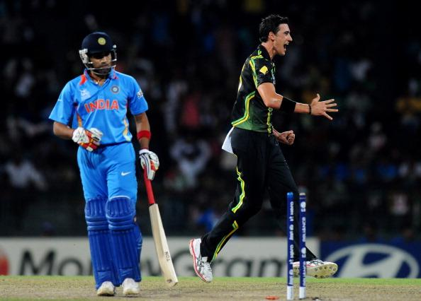 COLOMBO, SRI LANKA - SEPTEMBER 28:  Mitchell Starc of Australia celebrates the wicket of Rohit Sharma of India as the latter walks back during the super eight match between Australia and India held at R. Premadasa Stadium on September 28, 2012 in Colombo, Sri Lanka.  (Photo by Pal Pillai/Getty Images)