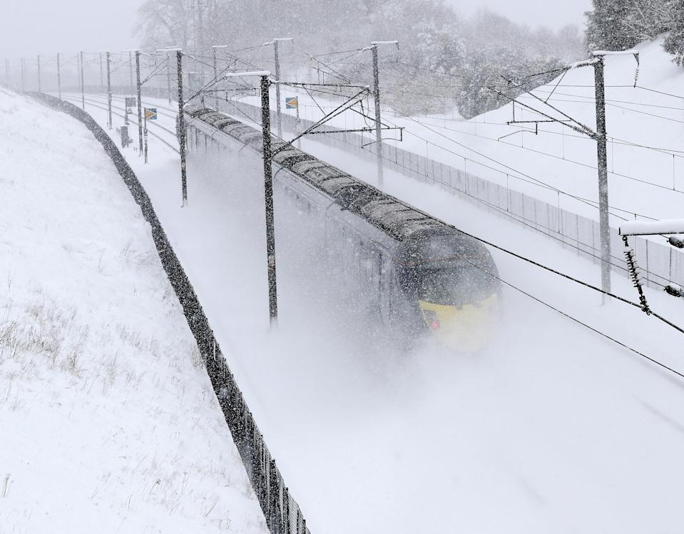 <p>Train passes through Kent near Maidstone during a snowstorm on it's way to London Terminus. Rail travellers have also been warned of cancellations and delays to services operated by TfL Rail, London Overground, c2c, Southeastern, Greater Anglia, Virgin Trains, Southern, South Western Railway and ScotRail. (Rex) </p>
