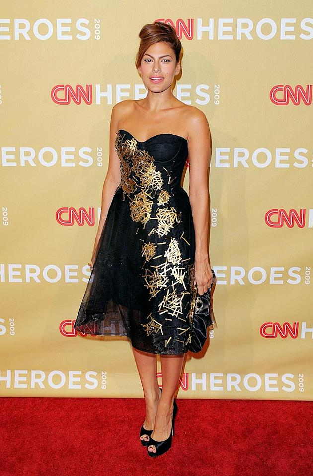 """Eva Mendes donned a flouncy black and gold frock to introduce the CNN Hero of the Year, Efren Penaflorida. The 21-year-old Filipino man created a program that encourages children living on the streets and in the slums of Philippines to choose education over gang life. Jason Merritt/<a href=""""http://www.gettyimages.com/"""" target=""""new"""">GettyImages.com</a> - November 21, 2009"""