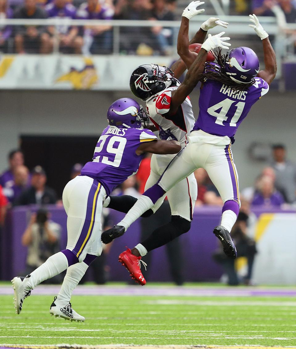 Anthony Harris #41 and Xavier Rhodes #29 of the Minnesota Vikings break up a pass intended for Julio Jones #11 of the Atlanta Falcons in the first quarter at U.S. Bank Stadium on September 8, 2019 in Minneapolis, Minnesota. (Photo by Adam Bettcher/Getty Images) *** Local Caption *** Anthony Harris; Xavier Rhodes; Julio Jones