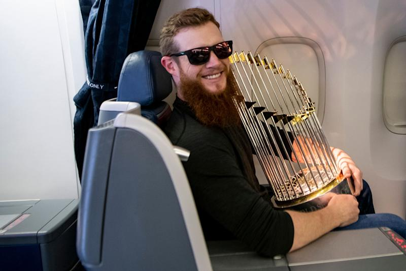 Craig Kimbrel with the Red Sox World Series trophy last October. The Cubs are hoping he'll bring them one. (Photo by Billie Weiss/Boston Red Sox/Getty Images)