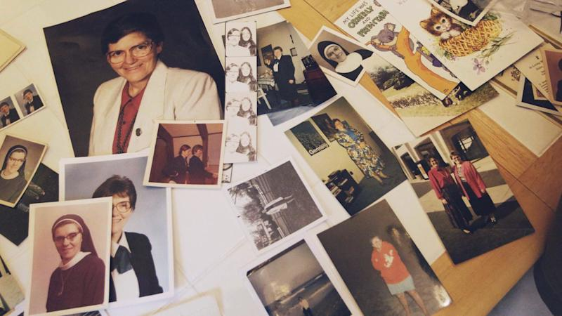 Photos of Sister Eileen Shaw are laid out on a table in Lancaster, Pennsylvania, by Trish Cahill. (Photo: HuffPost)