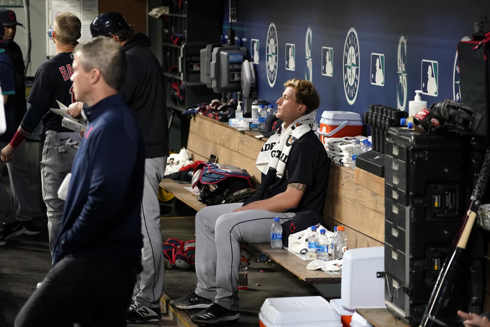 Cleveland Indians starting pitcher Zach Plesac sits in the dugout after the sixth inning of the team's baseball game against the Seattle Mariners on Thursday, May 13, 2021, in Seattle. (AP Photo/Elaine Thompson)