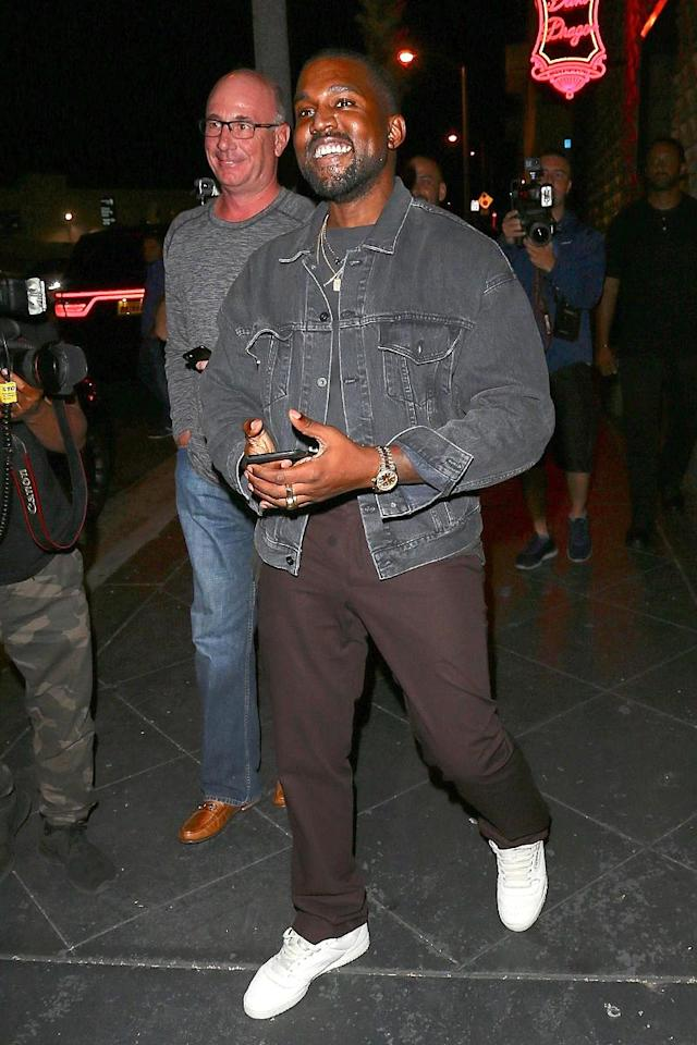 "<p>West is often serious, but he flashed a smile at the paparazzi outside Khloé Kardashian's <a href=""https://www.yahoo.com/celebrity/khloe-kardashian-apos-boyfriend-tristan-093300586.html"" data-ylk=""slk:surprise birthday party"" class=""link rapid-noclick-resp"">surprise birthday party</a> Sunday in L.A. Hey, who wouldn't be excited about gold-covered snacks! (Photo: BACKGRID) </p>"