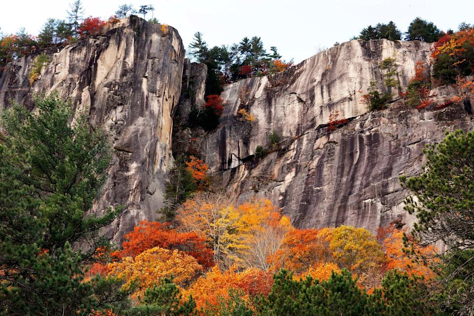 Fall colors are seen at New Hampshire's Cathedrel Ledge on Oct. 24, 2016, in Conway, N.H.