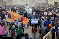 <p>Supporters of Kenyan opposition leader Raila Odinga of the National Super Alliance (NASA) coalition carry banners as they welcome Odinga's return in Nairobi, Kenya, Nov. 17, 2017. (Photo: Baz Ratner/Reuters) </p>
