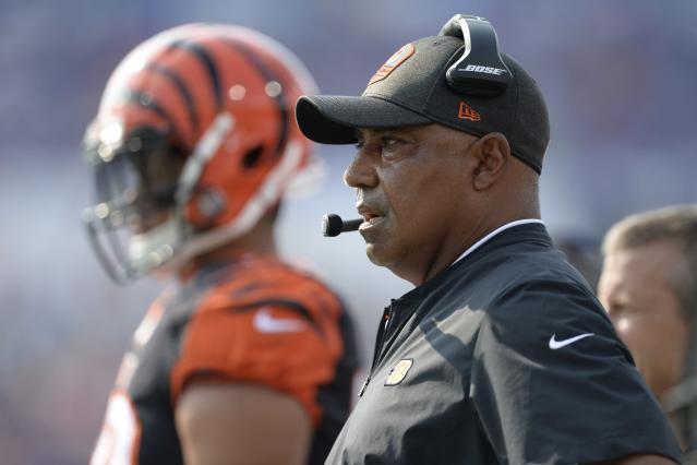 File-This Aug. 26, 2018, file photo shows Cincinnati Bengals head coach Marvin Lewis watching his team play during the first half of a preseason NFL football game against the Buffalo Bills in Orchard Park, N.Y. Lewis was noncommittal about sticking around, but was rewarded with a two-year extension and a 16th chance to try to get it right. Browns decision to stay with a coach who has the worst playoff record in NFL history sent a message of more-of-the-same in Cincinnati, where many fans have given up. (AP Photo/Adrian Kraus, File)