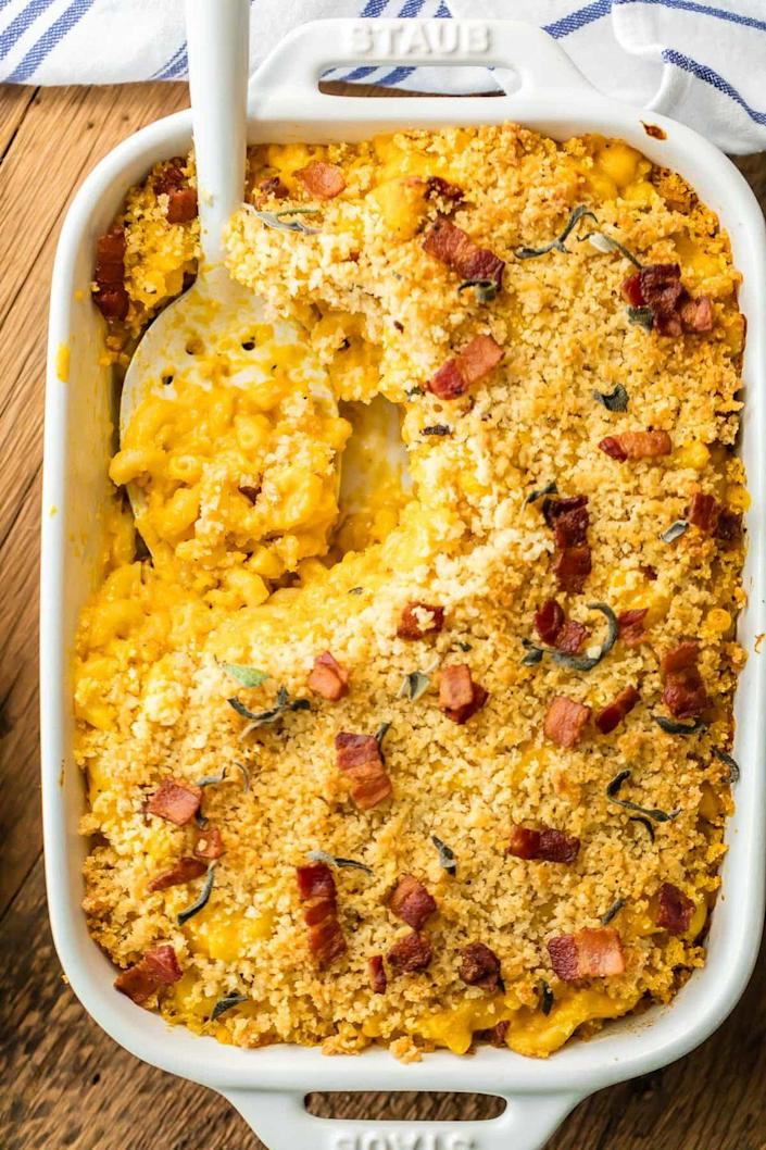 """<p>One bite of this baked mac and cheese and you'll be hooked. It's loaded with crispy bacon and sage, plus a can of pumpkin puree makes it extra creamy.</p><p><strong>Get the recipe at <a href=""""https://www.thecookierookie.com/pumpkin-bacon-mac-cheese/"""" rel=""""nofollow noopener"""" target=""""_blank"""" data-ylk=""""slk:The Cookie Rookie"""" class=""""link rapid-noclick-resp"""">The Cookie Rookie</a>. </strong> </p>"""