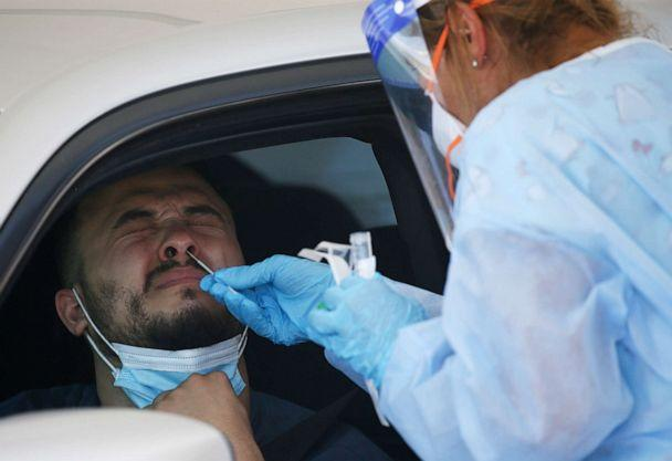 PHOTO: A man gets tested at a drive thru coronavirus testing site at South Mountain Community College in Phoenix, July 9, 2020. (Ross D. Franklin/AP)