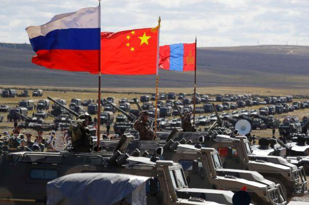 PHOTO: Russian, Chinese and Mongolian national flags set atop armored vehicles during military exercises in Eastern Siberia, Russia, Sept. 13, 2018. (Sergei Grits/AP)
