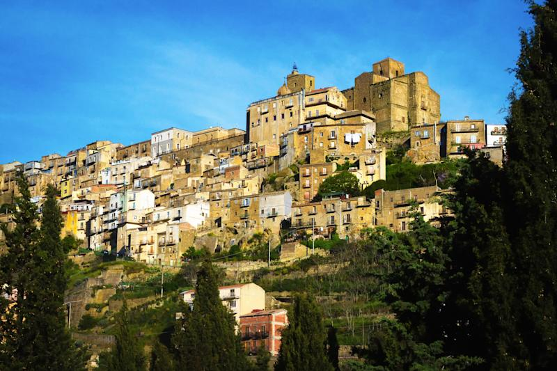 Panoramic view of the beautiful hill town of Troina, Sicily, in Enna Province. Copy space available in the bright blue sky. (Photo: JannHuizenga via Getty Images)