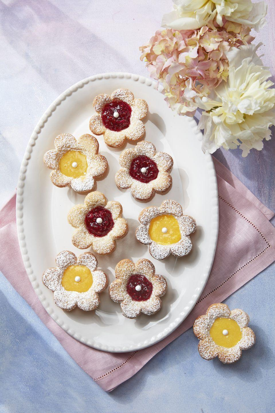 """<p>Don't be intimidated by the filling—store-bought jam or custard is all you need for these pretty little cookies.</p><p><strong><a href=""""https://www.countryliving.com/food-drinks/a30876783/flower-fruit-tarts-recipe/"""" rel=""""nofollow noopener"""" target=""""_blank"""" data-ylk=""""slk:Get the recipe"""" class=""""link rapid-noclick-resp"""">Get the recipe</a>.</strong></p><p><strong><a class=""""link rapid-noclick-resp"""" href=""""https://www.amazon.com/Fox-Run-3621-Flower-Stainless/dp/B001ET5YRA/?tag=syn-yahoo-20&ascsubtag=%5Bartid%7C10050.g.32944821%5Bsrc%7Cyahoo-us"""" rel=""""nofollow noopener"""" target=""""_blank"""" data-ylk=""""slk:SHOP COOKIE CUTTERS"""">SHOP COOKIE CUTTERS</a><br></strong></p>"""
