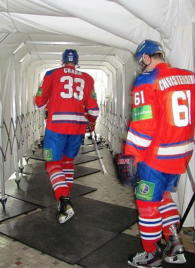 KHL teammates Zdeno Chara and Erik Christensen walk down the tunnel. (#NickInEurope)