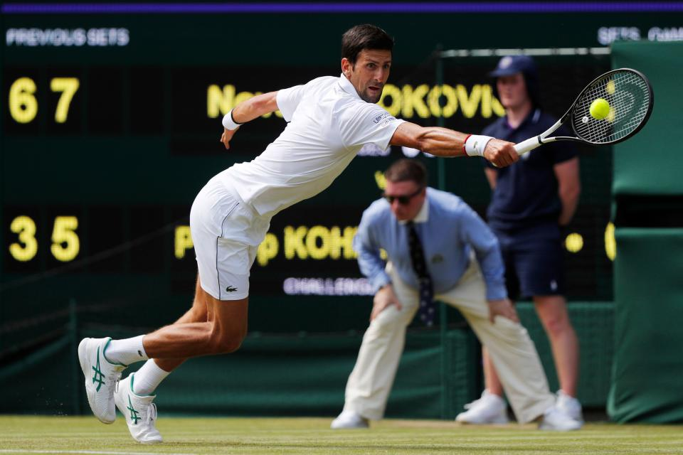 Serbia's Novak Djokovic returns the ball to Germany's Philipp Kohlschreiber during their men's singles first round match on the first day of the 2019 Wimbledon Championships at The All England Lawn Tennis Club in Wimbledon, southwest London, on July 1, 2019. (Photo by Adrian Dennis/AFP/Getty Images)