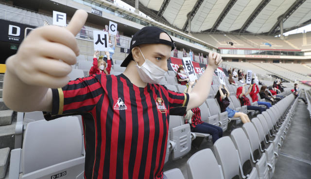 "In this May 17, 2020 photo, cheering mannequins are installed at the empty spectators' seats before the start of a soccer match between FC Seoul and Gwangju FC at the Seoul World Cup Stadium in Seoul, South Korea. A South Korean professional soccer club has apologized after being accused of putting sex dolls in empty stands during a match Sunday in Seoul. In a statement, FC Seoul expressed ""sincere remorse"" over the controversy, but insisted that it used mannequins, not sex dolls, to mimic a home crowd during its 1-0 win over Gwangju FC at the Seoul World Cup stadium. (Ryu Young-suk/Yonhap via AP)"