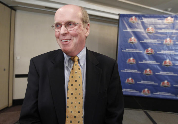 Bill Hancock, BCS executive director, smiles during an interview after a BCS presidential oversight committee meeting and media availability, Tuesday, June 26, 2012, in Washington. The committee announced a new post-season format for a four-team playoff for the major college football national championship. (AP Photo/Alex Brandon)