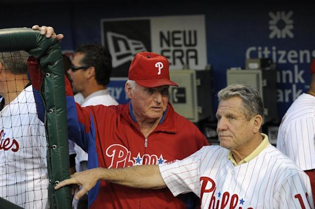 Philadlephia Phillies manager Charlie Manuel, left, talks to former Philadelphia Phillies shortstop Larry Bowa before a baseball game against the Atlanta Braves on Sunday, Aug. 4, 2013, in Philadelphia. (AP Photo/Michael Perez)