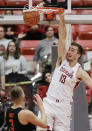 Washington State forward Jeff Pollard (13) dunks during the first half of an NCAA college basketball game against Oregon State in Pullman, Wash., Saturday, March 9, 2019. (AP Photo/Young Kwak)
