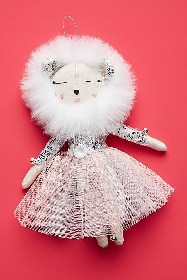 """<p>Notice the details on this adorable <a href=""""https://www.popsugar.com/buy/Alice-Mary-Lynch-Snow-Queen-Lioness-Ornament-490449?p_name=Alice%20Mary%20Lynch%20Snow%20Queen%20Lioness%20Ornament&retailer=anthropologie.com&pid=490449&price=20&evar1=casa%3Aus&evar9=46615300&evar98=https%3A%2F%2Fwww.popsugar.com%2Fhome%2Fphoto-gallery%2F46615300%2Fimage%2F46615319%2FAlice-Mary-Lynch-Snow-Queen-Lioness-Ornament&list1=shopping%2Canthropologie%2Choliday%2Cchristmas%2Cchristmas%20decorations%2Choliday%20decor%2Chome%20shopping&prop13=mobile&pdata=1"""" rel=""""nofollow noopener"""" class=""""link rapid-noclick-resp"""" target=""""_blank"""" data-ylk=""""slk:Alice Mary Lynch Snow Queen Lioness Ornament"""">Alice Mary Lynch Snow Queen Lioness Ornament</a> ($20).</p>"""