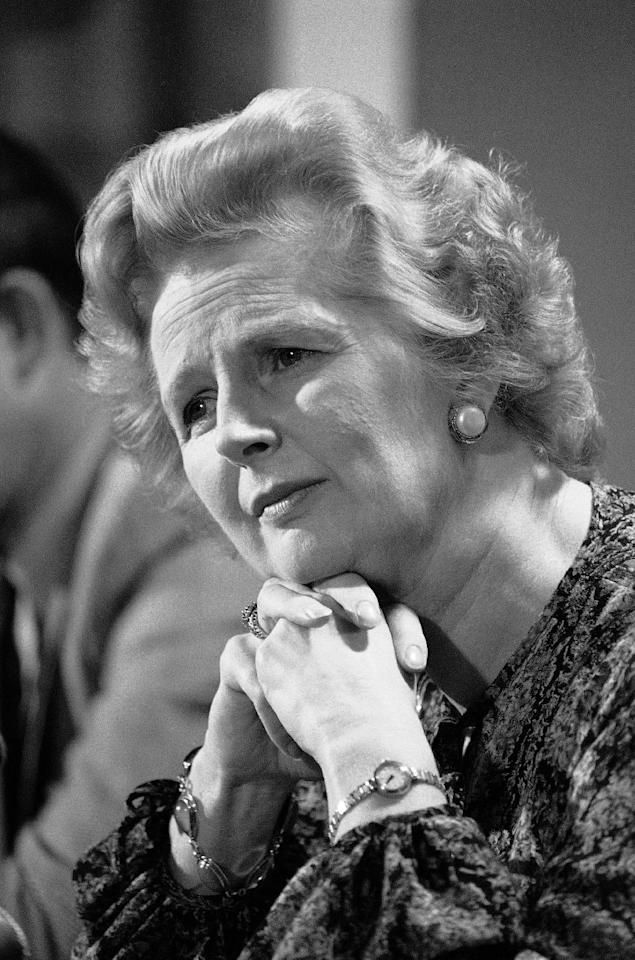 "FILE - In this Sept. 14, 1977 file photo, British Conservative Party Leader Margaret Thatcher listens to a reporters question during a press conference at the British Embassy in Washington. Ex-spokesman Tim Bell says that Thatcher has died. She was 87. Bell said the woman known to friends and foes as ""the Iron Lady"" passed away Monday morning, April 8, 2013. (AP Photo/File)"