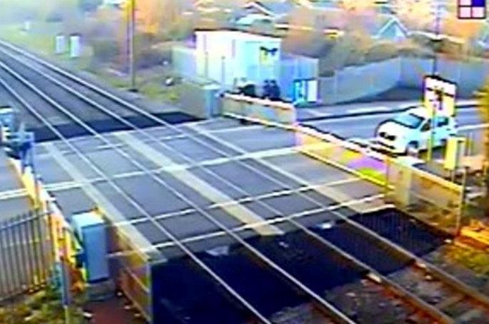 Network Rail warned people not to interfere with level crossings as it released the footage. (SWNS)
