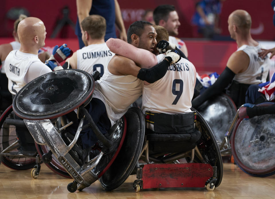Great Britain's wheelchair rugby stars celebrate victory in the gold medal match against USA
