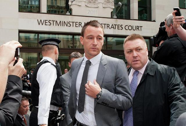 Chelsea footballer John Terry (C) leaves Westminster Magistrates court in London, on July 13, 2012 as he was found not guilty of racially abusing rival footballer Anton Ferdinand (AFP Photo/WILL OLIVER)