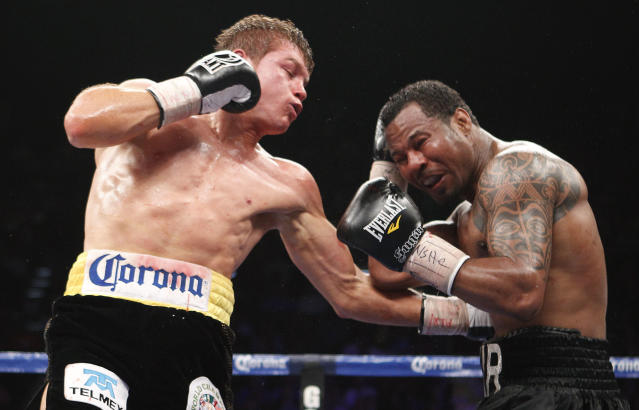 Canelo Alvarez, left, lands a body punch against Shane Mosley in the fifth round during a WBC super welterweight title fight, Saturday, May 5, 2012, in Las Vegas. (AP Photo/Eric Jamison)