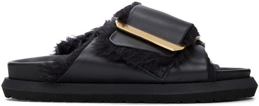 "<br><br><strong>Sacai</strong> Black Faux-Fur Sandals, $, available at <a href=""https://go.skimresources.com/?id=30283X879131&url=https%3A%2F%2Fwww.ssense.com%2Fen-us%2Fwomen%2Fproduct%2Fsacai%2Fblack-faux-fur-sandals%2F5618921%3Fgclid%3DCjwKCAjw0On8BRAgEiwAincsHFGYomQZg8h-XcK7At5dx4bREeIm_yHqoMLqVYJrmn41JmWOgicc8hoChZMQAvD_BwE"" rel=""nofollow noopener"" target=""_blank"" data-ylk=""slk:SSENSE"" class=""link rapid-noclick-resp"">SSENSE</a>"