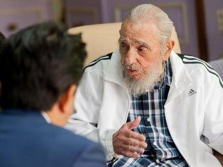 Cuba's former President Fidel Castro (R) and Japan's Prime Minister Shinzo Abe meet in Havana, Cuba, September 22, 2016, in this handout photo provided by Cubadebate. Alex Castro/Cubadebate/Handout via Reuters