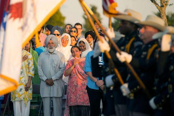 PHOTO: The family of Harris County Deputy Sandeep Dhaliwal watches as an honor guard begins a vigil to honor Dhaliwal in Houston, Texas, Sept. 30, 2019. (Mark Mulligan/Houston Chronicle via AP)