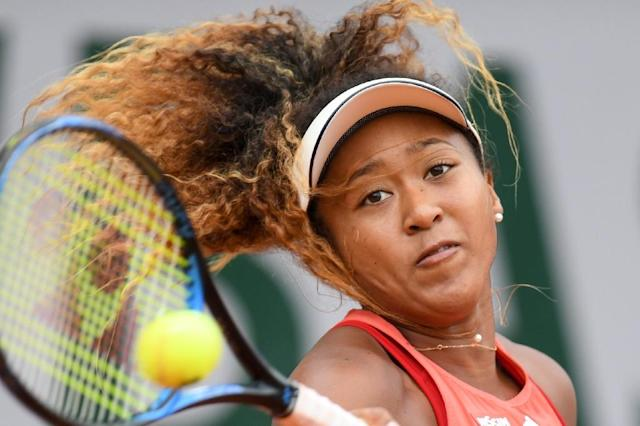 Eyes on a third Slam: Naomi Osaka in action at the 2018 tournament (AFP Photo/CHRISTOPHE ARCHAMBAULT )