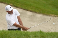 Lucas Glover hits out of a bunker on the 18th green during the final round of the John Deere Classic golf tournament, Sunday, July 11, 2021, at TPC Deere Run in Silvis, Ill. (AP Photo/Charlie Neibergall)