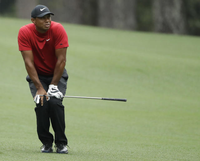 Tiger Woods reacts to his shot on the second hole during the final round for the Masters golf tournament Sunday, April 14, 2019, in Augusta, Ga. (AP Photo/Marcio Jose Sanchez)