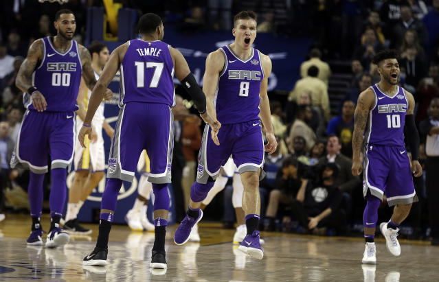 Sacramento Kings' Bogdan Bogdanovic celebrates a go-ahead bucket against the Warriors late in the fourth quarter on Monday night. (AP Photo)