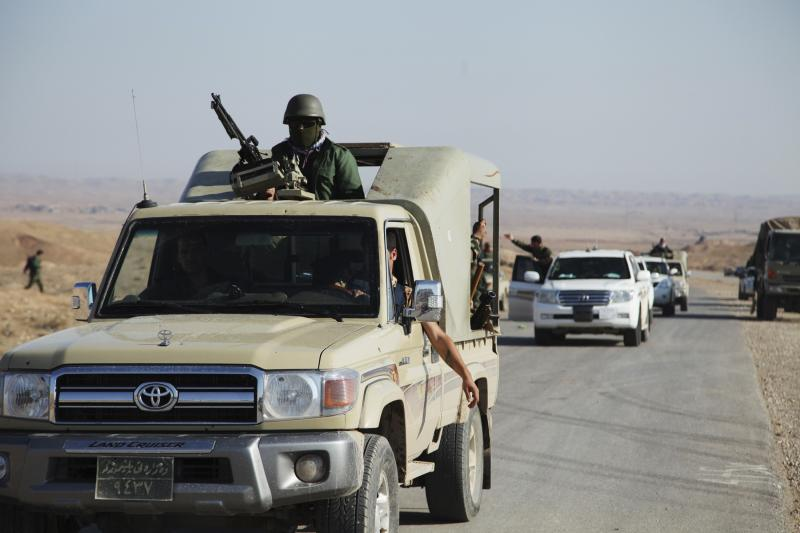 Members of the Kurdish security forces ride in vehicles during an intensive security deployment in Diyala province north of Baghdad