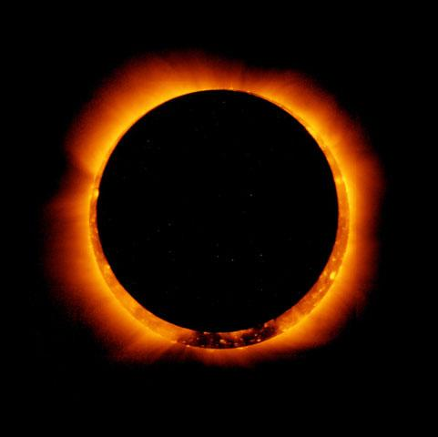 In this handout provided by NASA, sun spots are seen as the moon moves into a full eclipse position after reaching annularity during the first annular eclipse seen in the U.S. since 1994 on May 20, 2012.  Differing from a total solar eclipse, the moon in an annular eclipse appears too small to cover the sun completely, leaving a ring of fire effect around the moon. The eclipse is casting a shallow path crossing the West from west Texas to Oregon then arcing across the northern Pacific Ocean to Tokyo, Japan.  (Photo by JAXA/NASA/Hinode via Getty Images)