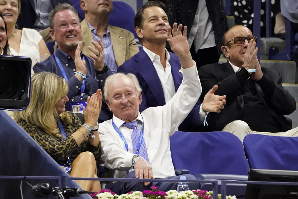 Rod Laver, second from left on bottom, waves to the crowd during the semifinals of the US Open tennis championships between Novak Djokovic, of Serbia, and Alexander Zverev, of Germany, Friday, Sept. 10, 2021, in New York. (AP Photo/John Minchillo)