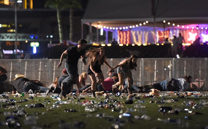 Fans run from the Route 91 Harvest festival aftera gunman opened fire.
