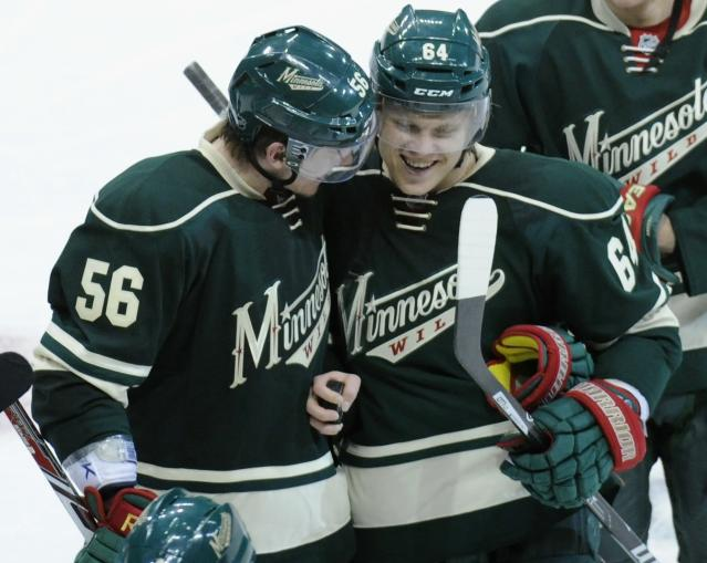 ST PAUL, MN - APRIL 21: Erik Haula #56 and Mikael Granlund #64 of the Minnesota Wild celebrate a win against the Colorado Avalanche in Game Three of the First Round of the 2014 NHL Stanley Cup Playoffs on April 21, 2014 at Xcel Energy Center in St Paul, Minnesota. The Wild defeated the Avalanche 1-0 in overtime. (Photo by Hannah Foslien/Getty Images)