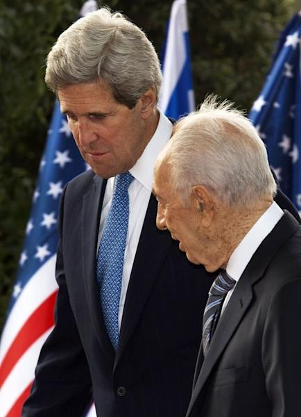 US Secretary of State John Kerry (L) talks with Israeli President Shimon Perez before the start of their private meeting on April 8, 2013, at Perez's official residence in Jerusalem