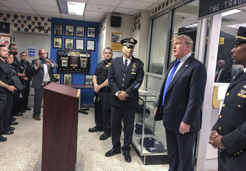 Former President Donald Trump, second from right, commemorated the 20th anniversary of the Sept. 11 attacks by visiting the NYPD's 17th police precinct in New York, where he criticized President Biden over the pullout from Afghanistan, Saturday Sept. 11, 2021. (AP Photo/Jill Colvin)