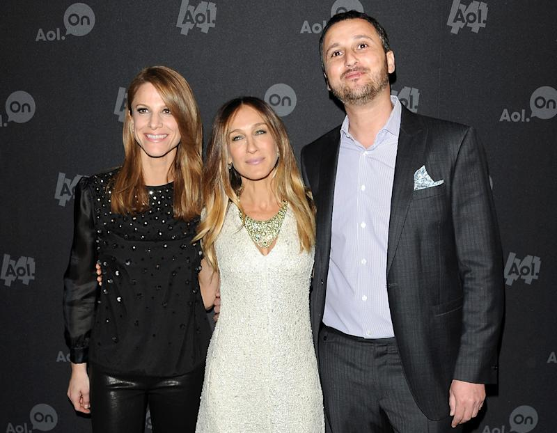 """AOL's general manager for branded entertainment Karen Cahn, left, actress Sarah Jessica Parker and AOL's senior VP of Video Ron Harnevo attend AOL's web series """"NewFront"""" at Moynihan Station on Tuesday April 30, 2013 in New York. (Photo by Evan Agostini/Invision/AP)"""