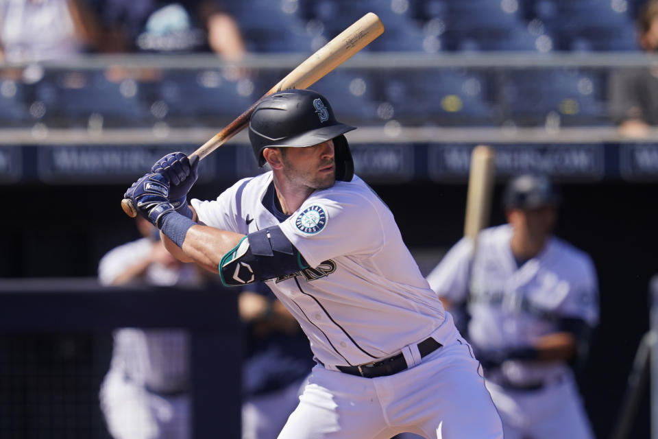 Seattle Mariners' Mitch Haniger bats during a spring training baseball game against the Oakland Athletics, Saturday, March 6, 2021, in Peoria, Ariz. (AP Photo/Sue Ogrocki)