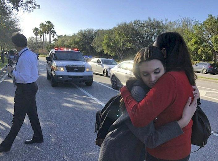 Students react at Marjory Stoneman Douglas High School.