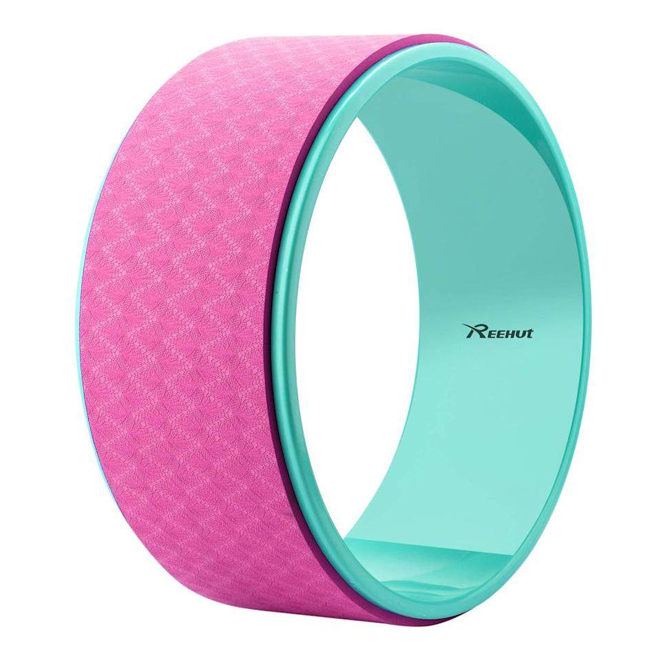 """<h3>Yoga Wheel</h3> <br>""""When it comes to props that I personally use, I love yoga wheels,"""" Maria says. While not necessary for most poses, wheels offer back support during bridge poses, in addition to stretching the shoulder, spine, and hips. <br><br><strong>Reehut</strong> Yoga Wheel for Back Pain, $, available at <a href=""""https://amzn.to/2UNrKLv"""" rel=""""nofollow noopener"""" target=""""_blank"""" data-ylk=""""slk:Amazon"""" class=""""link rapid-noclick-resp"""">Amazon</a><br>"""